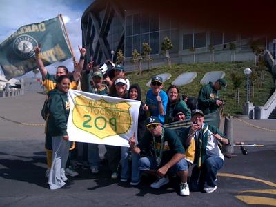 Left field bleacher fans with 209 banner