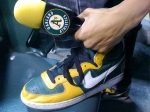 A's sneakers and microphone go hand in hand
