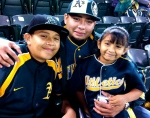 Cute A's family after winning a copy of the MLB2K11 video game