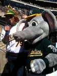 "Stomper with singer/songwriter Brett Dennen performing ""Take me out to the Ballgame"""